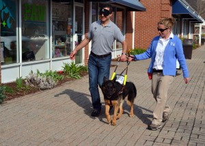 Avon Resident Liz DiPace of the Fidelco Guide Dog Foundation (right) shows how service dogs guide people who are visually impaired. Blindfolded is West Hartford resident Corey Shagensky, DVM, of Progressive Animal Wellness (PAW) in Avon